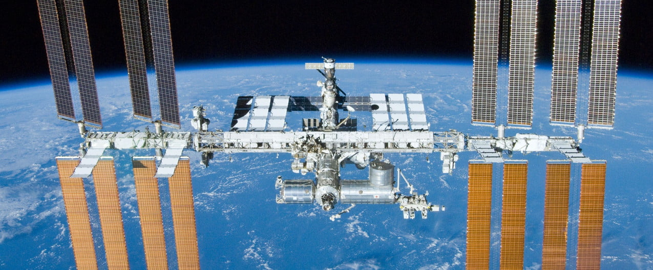 The International Space Station orbiting the Earth.