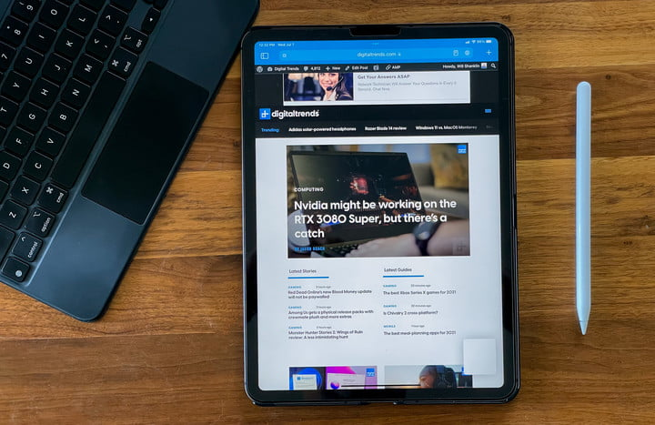 iPad Pro running iPadOS 15, with the Digital Trends homepage on the screen, Apple Pencil to the right and keyboard to the left.
