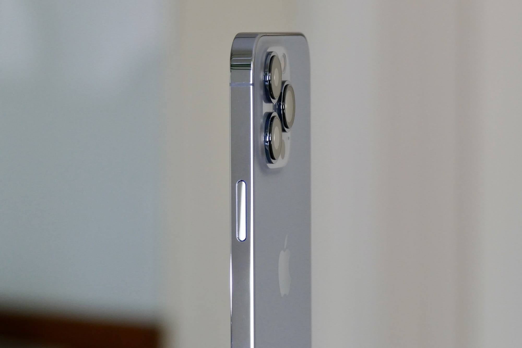 The iPhone 13 Pro's camera module seen from the side.