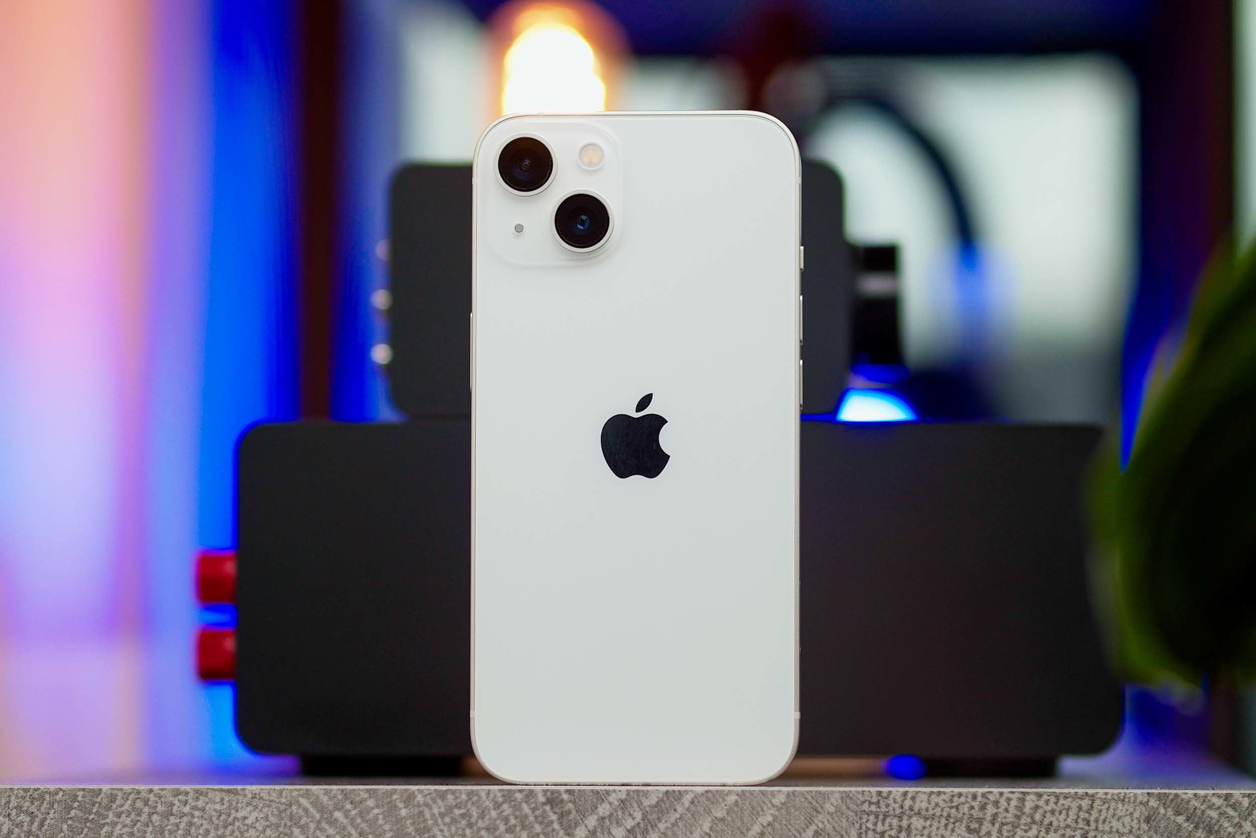 iPhone 13 standing upright showing back.