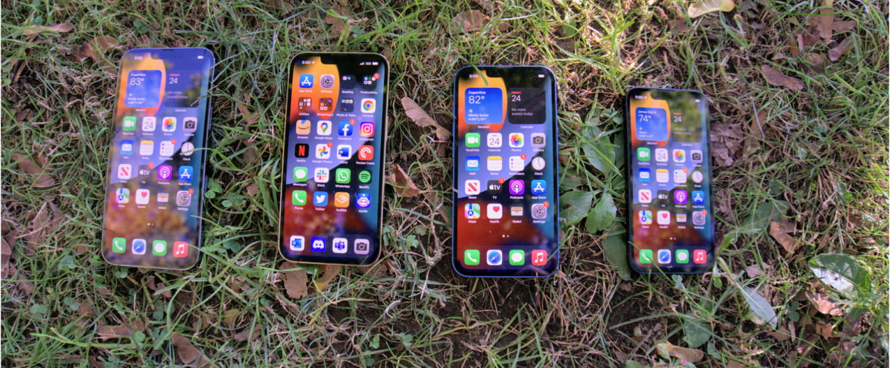 iPhone 13 models arrayed with screen on.