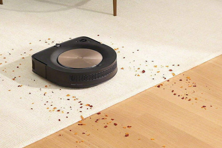 The iRobot Roomba s9 cleaning.