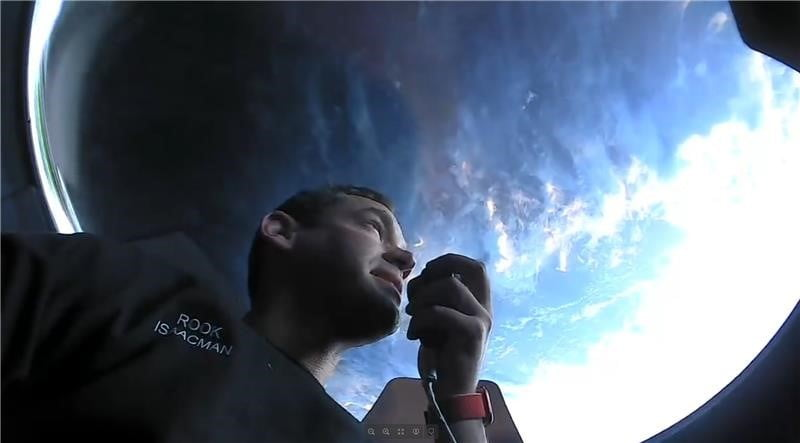 Jared Isaacman looking out out of the Crew Dragon's cupola.