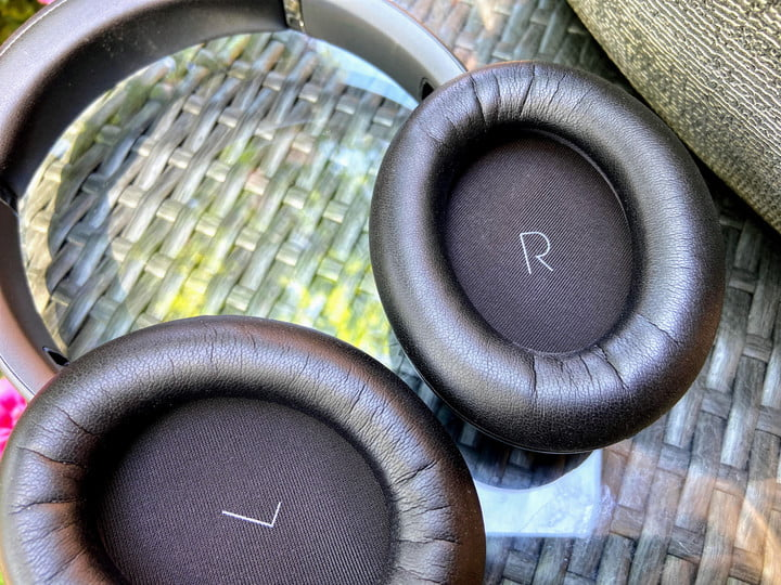 JBL Tour One wireless noise canceling headphones earcups close-up.