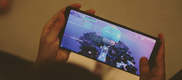 Someone playing Fortnite on a phone