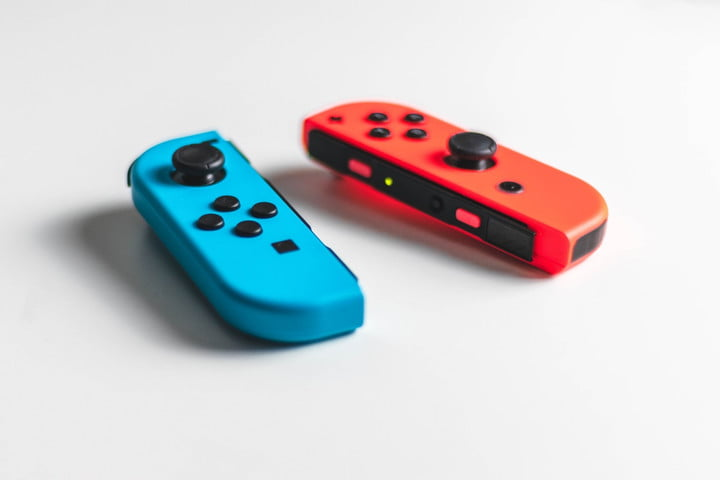Switch controllers on a white surface.