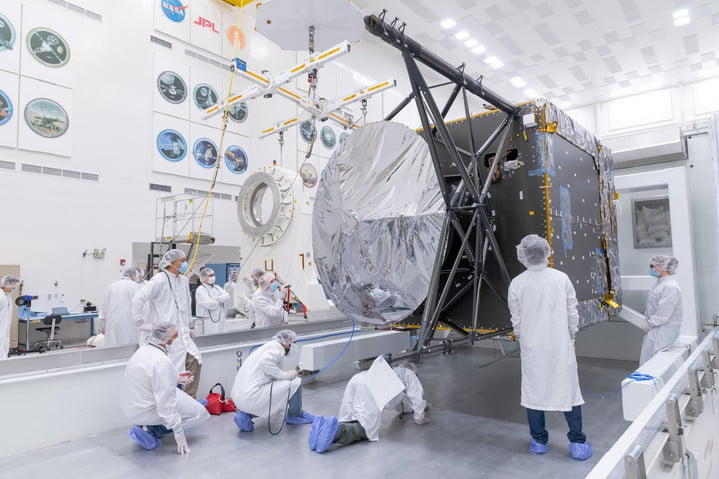 Engineers and technicians prepare to move the chassis of NASA's Psyche spacecraft from its shipping container to a dolly inside JPL's Spacecraft Assembly Facility just after the chassis was delivered by Maxar Technologies in late March of 2021.