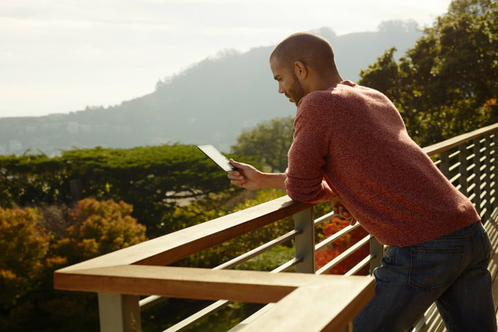 young americans prefer to read kindle oasis man reading outside