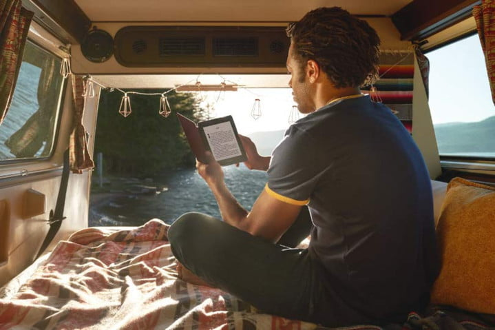Reading a Kindle Paperwhite in van