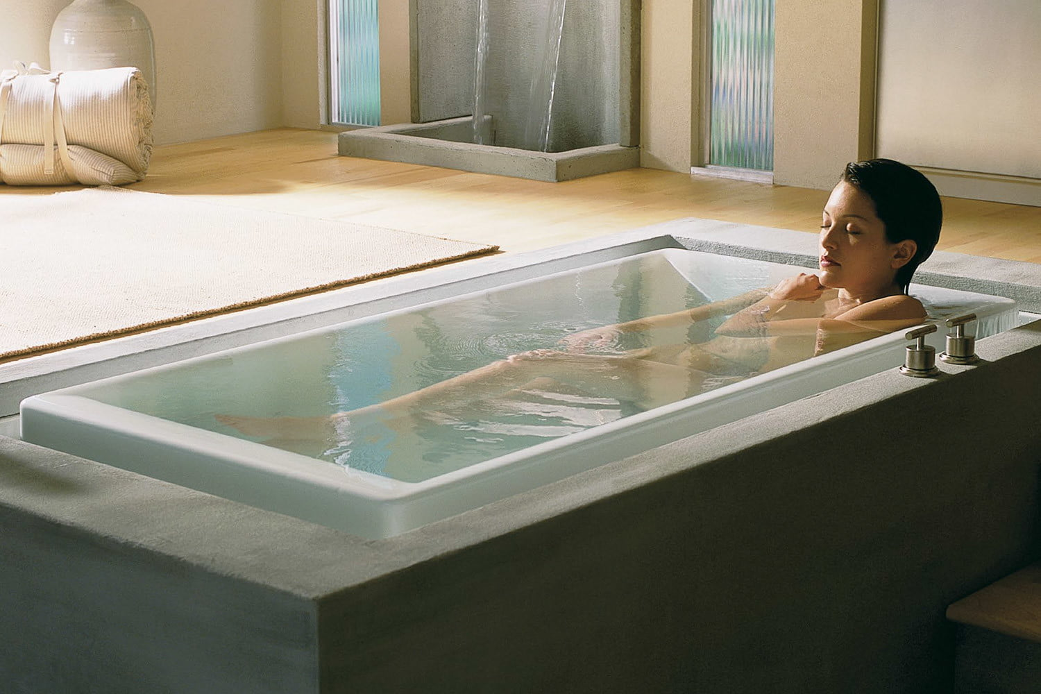 tech to set the mood in bedroom on valentines day kohler vibracoustic  bubblemassage combination hydrotherapy bath