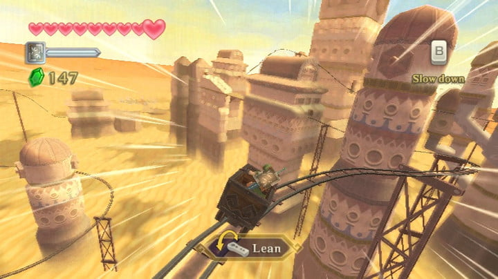 Link riding a minecart in the desert.