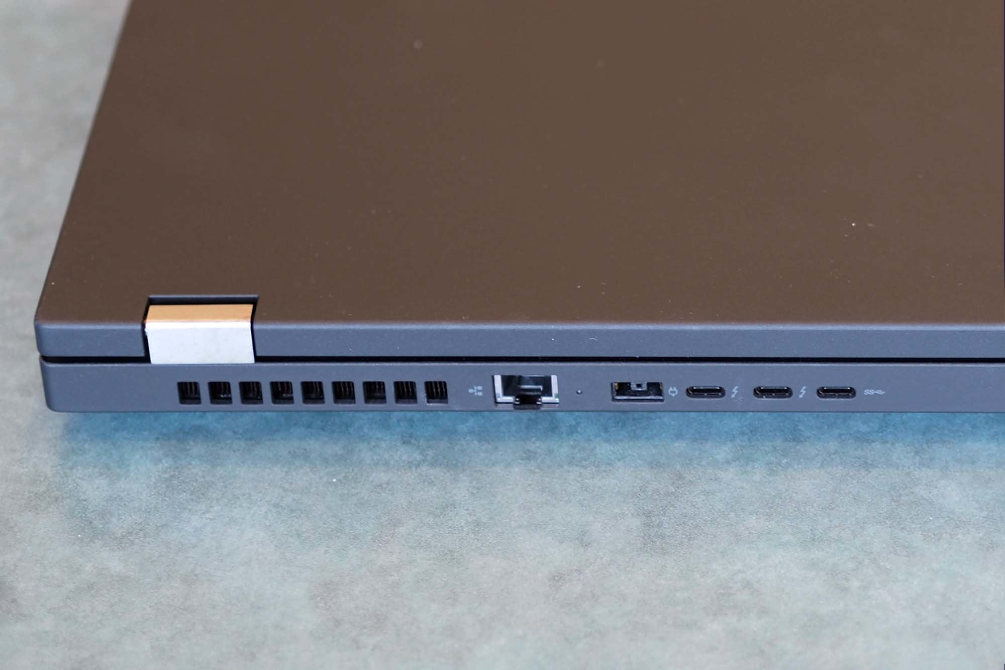 Ethernet cable plugin, charging port, & three micro USB ports on the back of a Lenovo ThinkPad P15 Gen 2 laptop.