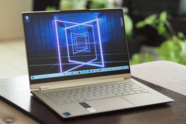 The Lenovo Yoga 91 laptop with the screen showing a scene with lasers.