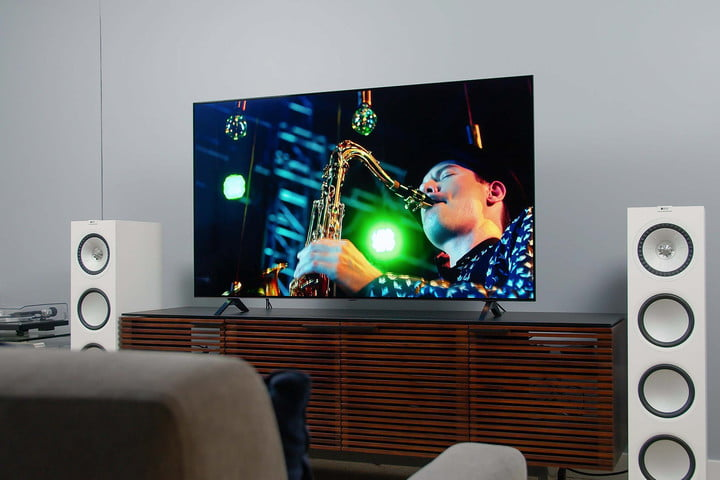 LG A1 OLED 4K HDR TV screen displaying imagery of someone playing the saxophone.