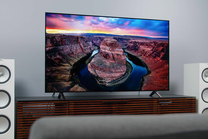 LG A1 OLED 4K HDR TV screen displaying imagery of a colorful landscape at sunset.