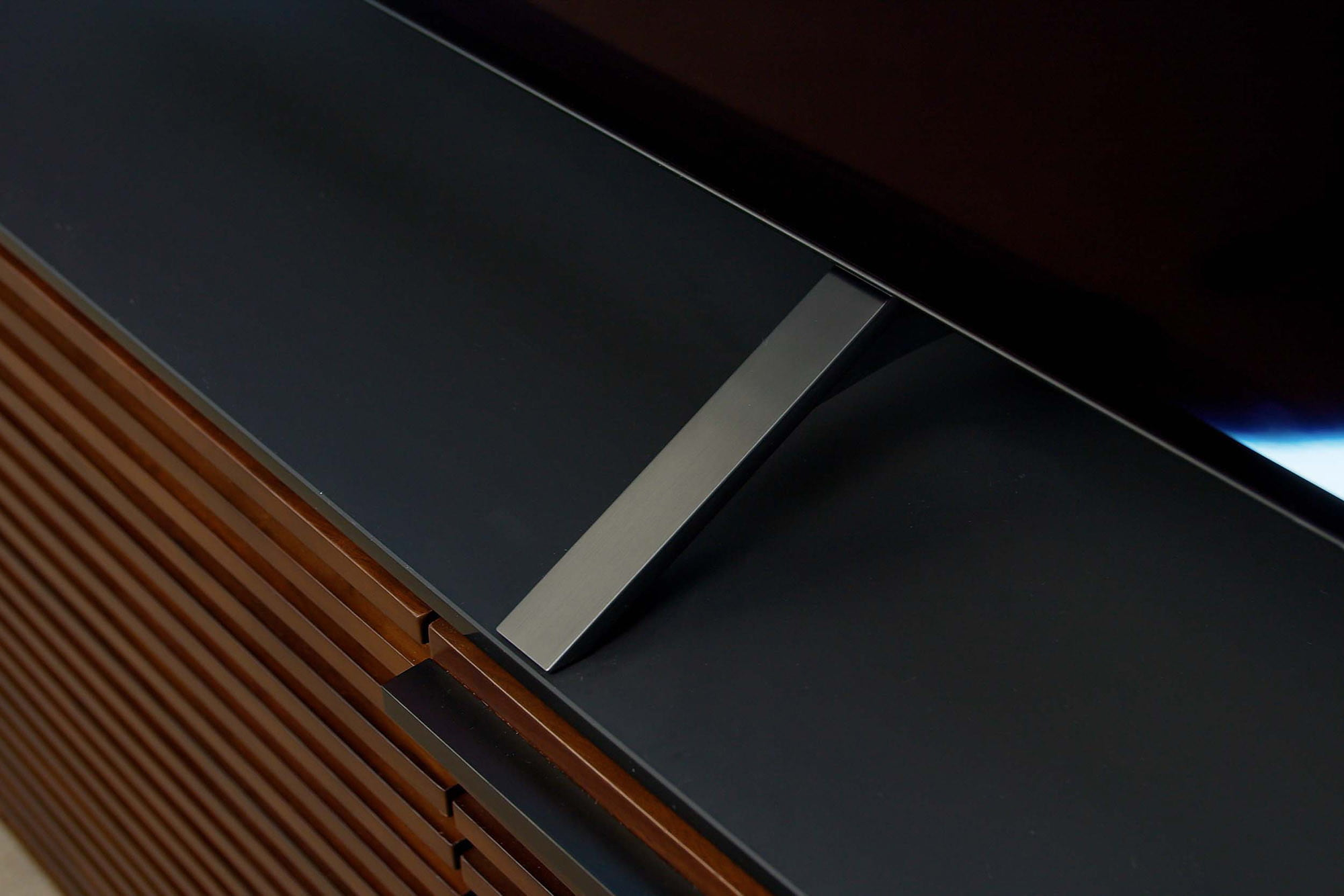 Close up image of the LG A1 OLED 4K HDR TV's stand