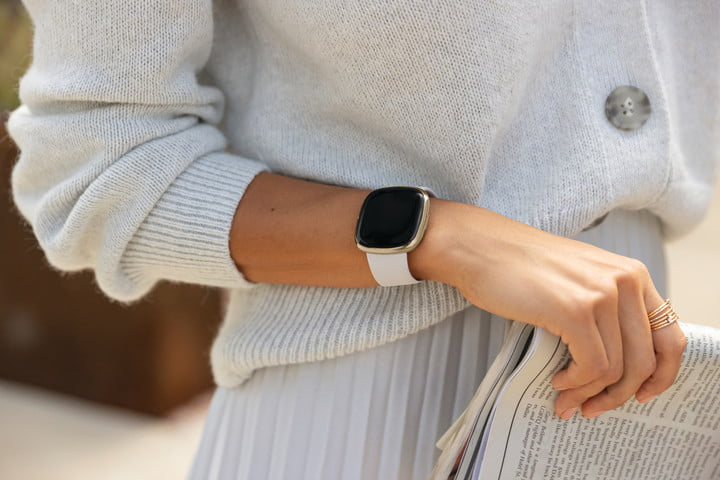 Close up shot of a woman wearing the Fitbit Sense on her wrist
