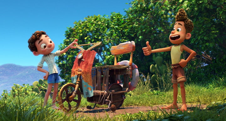 Luca and Alberto give a thumbs-up sign to their homemade Vespa scooter in a scene from Pixar's Luca.