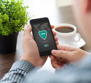 best vpn for small business man holding phone app creation internet protocols protection network