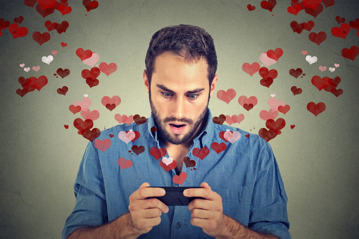 eharmony future dating iot smart tech man sending receiving love sms text message on mobile phone with red hearts