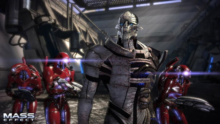 Seran and red geth in a grey room.