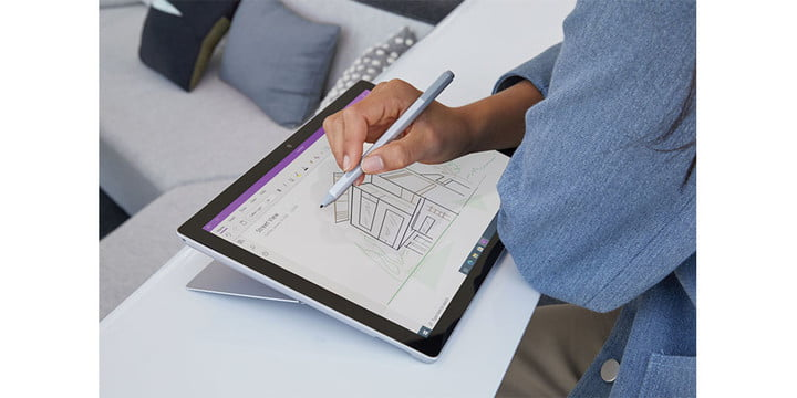 Microsoft Surface Pro 7 in tablet mode with someone using a stylus on it.