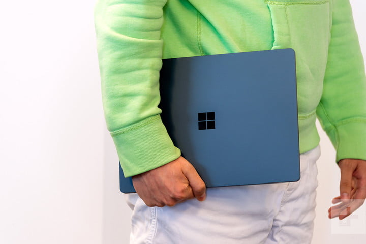 Microsoft Surface Laptop in hand
