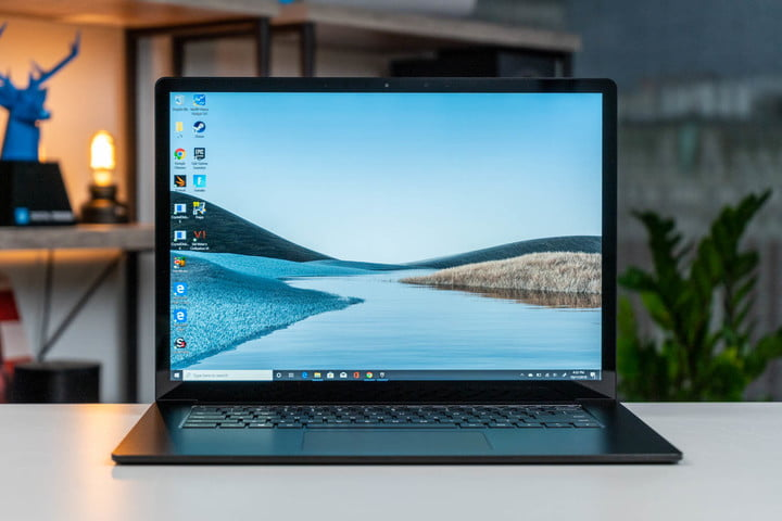 The Microsoft Surface Laptop 3 with a nature scene on the display.