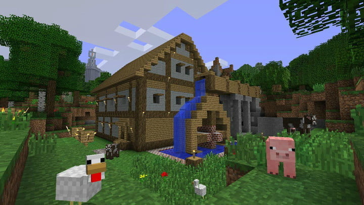 A wooden house with a waterwheel and animals outside.