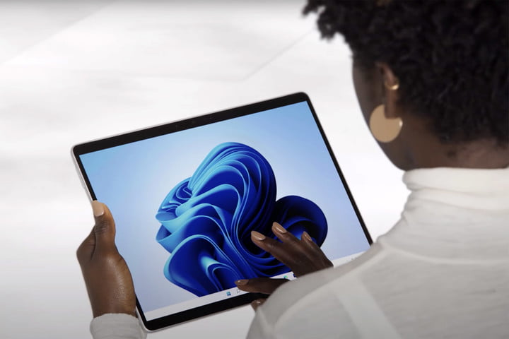 A woman holding the newly announced Microsoft Surface Pro 8.
