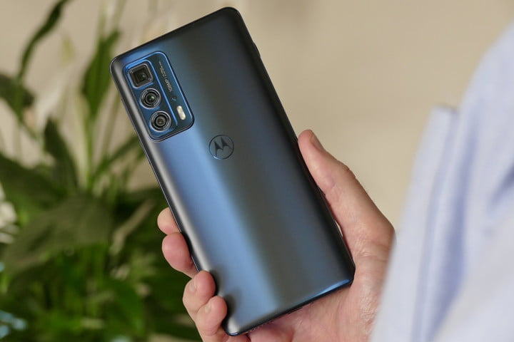 Moto Edge 20 Pro held in hand, seen from the back.