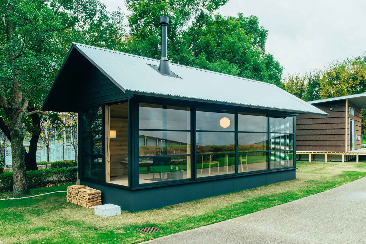 the muji hut is a micro home made for japan of wood 03