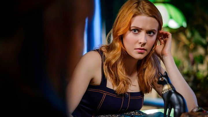 Nancy Drew looking at someone in the foreground who is blurred out on Netflix.