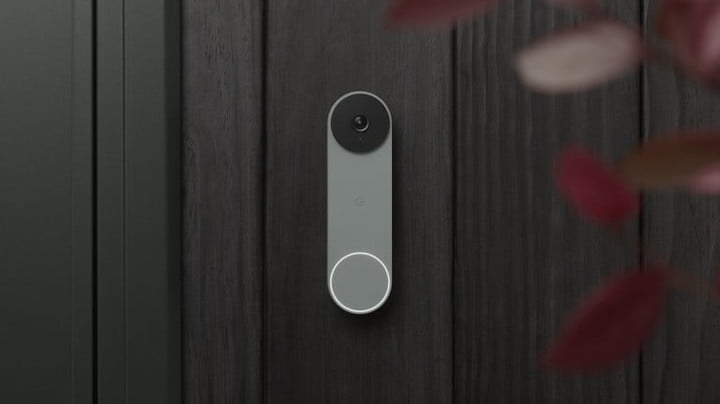 The Nest Doorbell attached to a wooden wall.