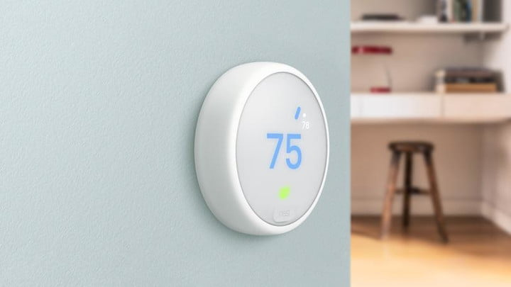 The Nest E Thermostat mounted near a kitchen.