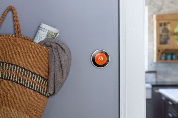 The Nest Learning Thermostat mounted on the wall.