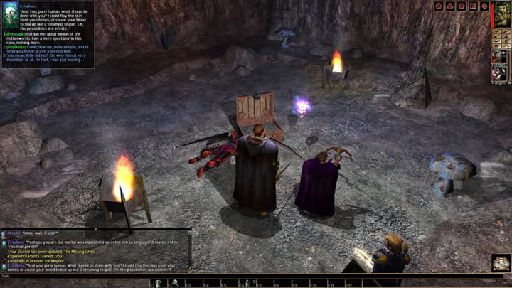 Two adventurers looting a chest in a cave.