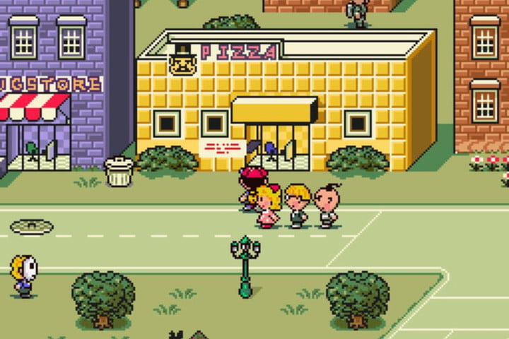 Ness and his friends outside a Pizza place.