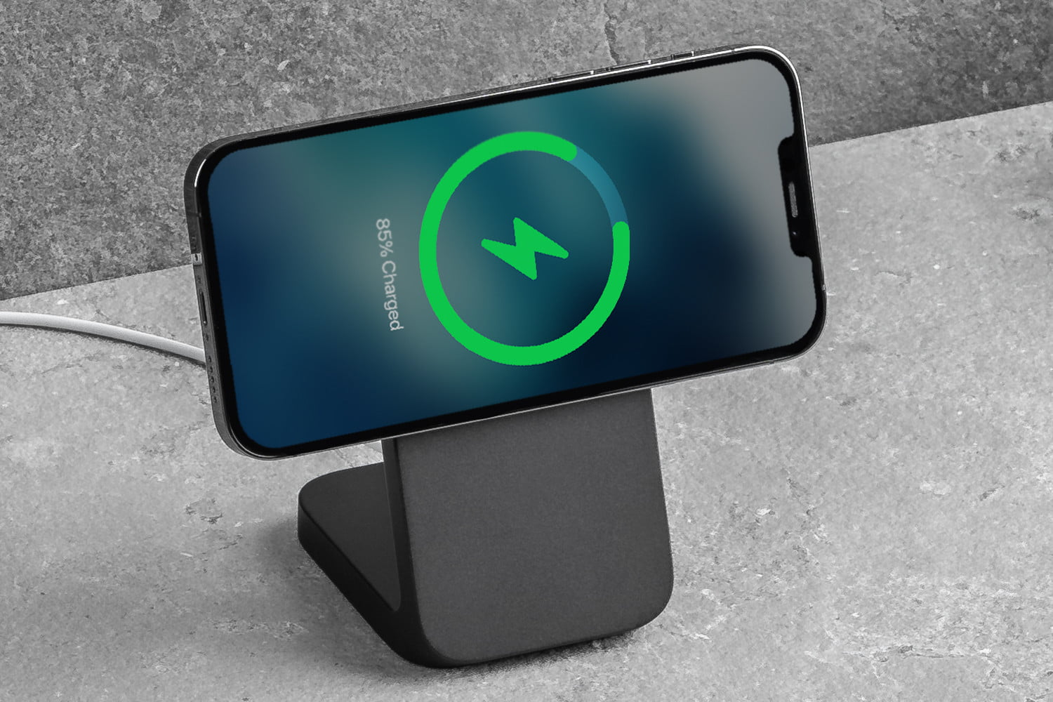 Nomad MagSafe Mount Stand with iPhone charging in landscape orientation.