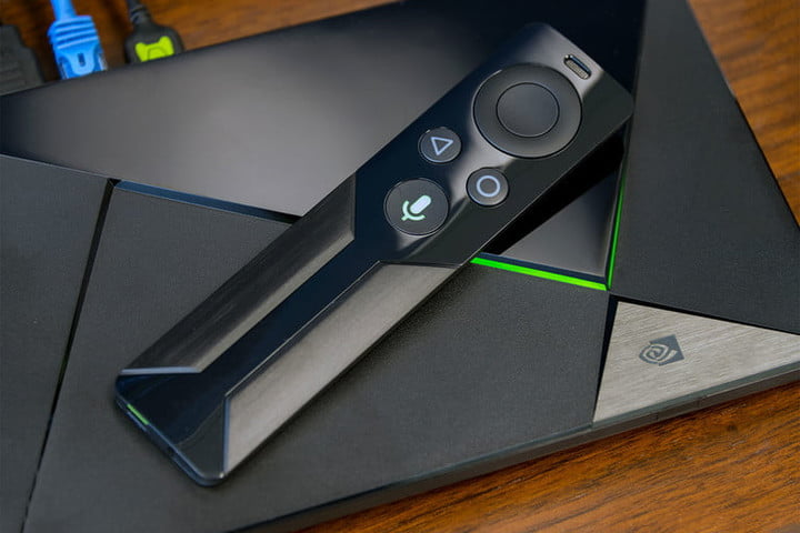 Nvidia Shield 16gb Android TV with controller on top.