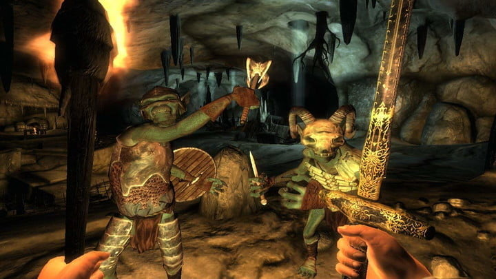 A knight fighting two goblins with a torch and a sword.