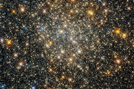 Hubble peered through dust and gas to capture this dazzling globular cluster