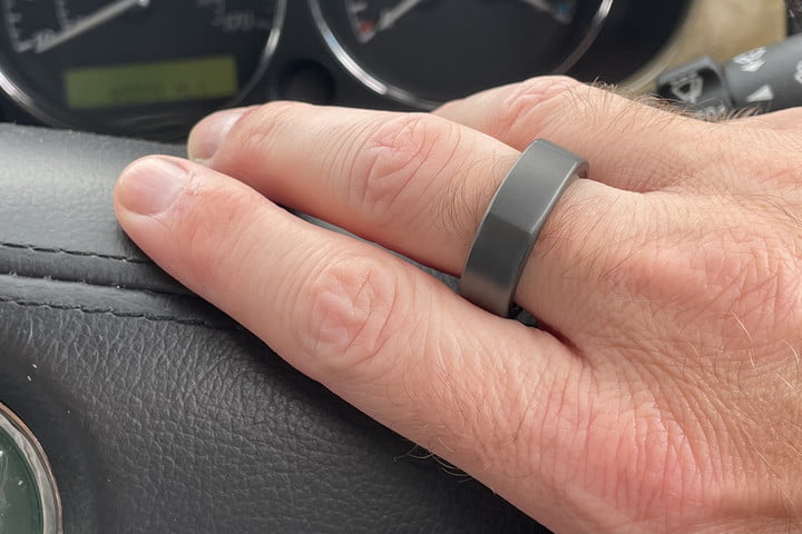 The Oura Ring from the side on a finger.