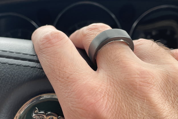The Oura Ring on a finger, seen from the back.
