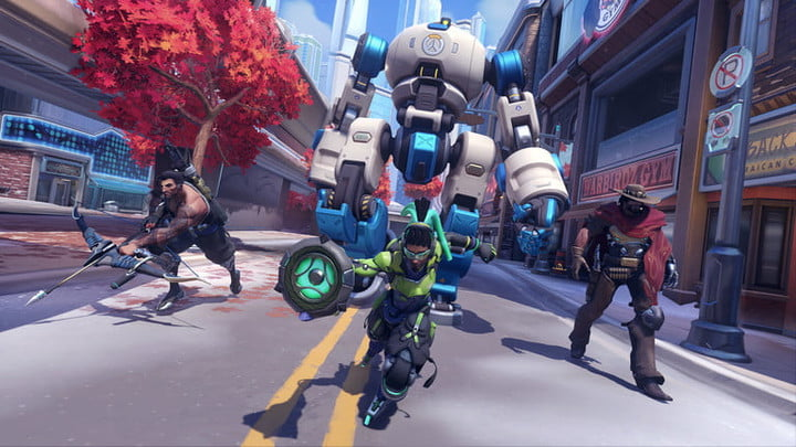 A team of Overwatch characters advance up a street in Overwatch 2.