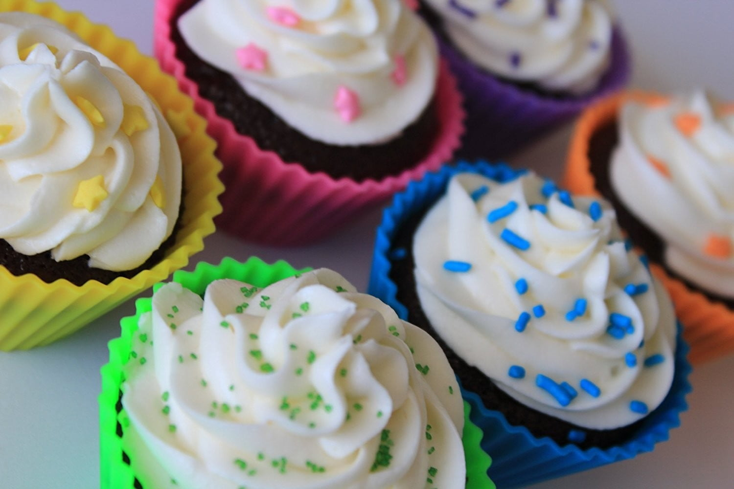 pantry-elements-silicone-cupcake-liners-baking-cups-with cupcakes in them