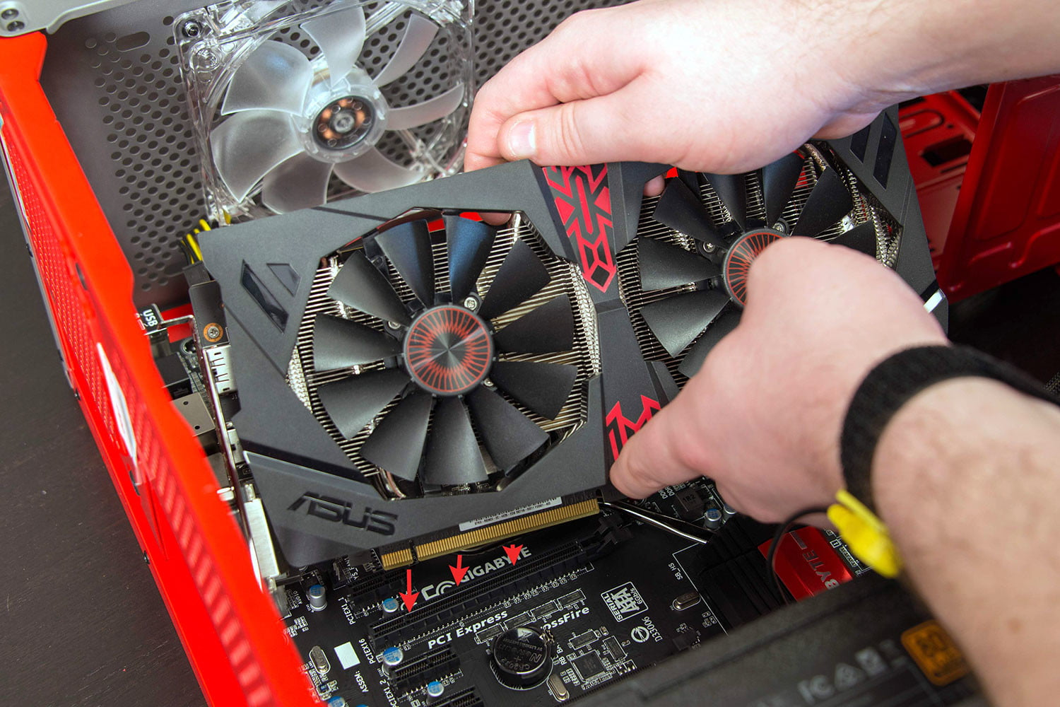 Graphics card going into motherboard slot.
