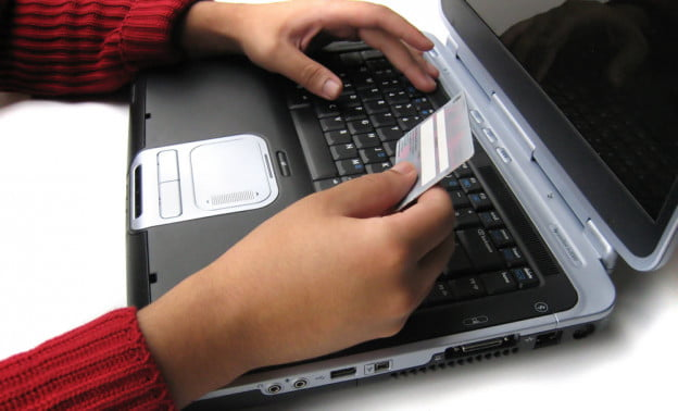 person laptop credit card