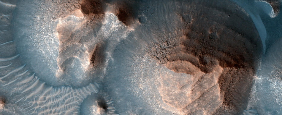 This image shows several craters in Arabia Terra that are filled with layered rock, often exposed in rounded mounds. The bright layers are roughly the same thickness, giving a stair-step appearance. The process that formed these sedimentary rocks is not yet well understood. They could have formed from sand or volcanic ash that was blown into the crater, or in water if the crater hosted a lake. The image was taken by a camera, the High Resolution Imaging Experiment, on NASA's Mars Reconnaissance Orbiter.