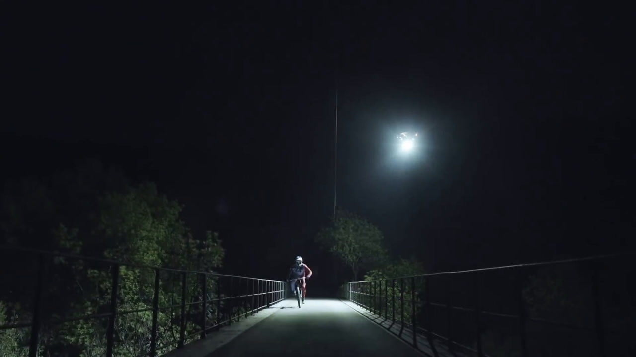 loic bruni red bull mountain biker uuses led equipped drones to bike at night